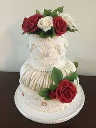 classic white ivory wedding cake with red white and ivory sugar