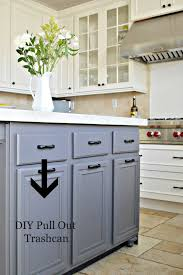 build a kitchen island out of cabinets turn a door and a drawer into a pull out trash can