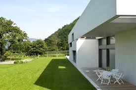 outdoor backyard with grass and plants are also white circular