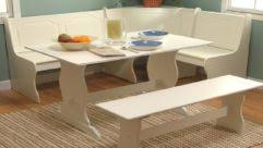 breakfast nook table with white swivel chairs set and varnished