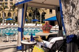 pool amenities the ritz carlton naples a cabana offers shade and refreshments over poolside seating