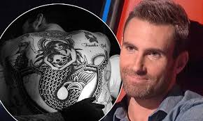 adam levine of maroon 5 unveils of mermaid clutching a