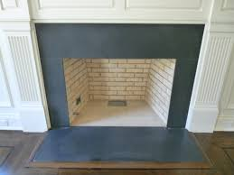 marble and granite photos traditional living room new york slate fireplace tile black face and hearth installing over surround
