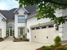 vintage garage doors kansas city st louis renner raised panel with arched thames windows and alpine handles in almond
