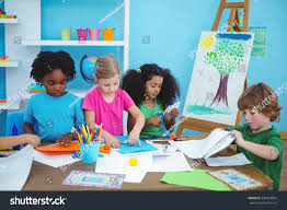 happy kids doing arts crafts together stock photo 338324834