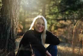woman siting smiling beside tree free image peakpx