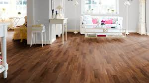 black walnut wood flooring as well as lounge chairs and a