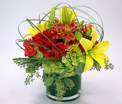 florist knoxville tn floral arrangement lilies roses grass caged beauty