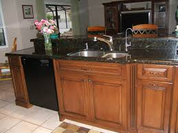 Cognac Kitchen Cabinets by Maple Kitchen Cabinets With Black Appliances Home Design Ideas