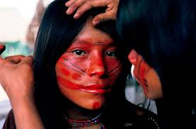 ashaninka indians apply face paint each day in a design that