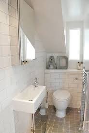 loft bathroom ideas velux window above toilet in small attic bathroom with open shower