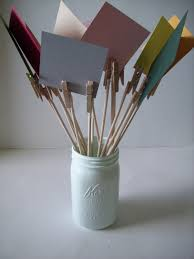 how about this idea buy mini clothespin attach them to sticks