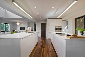 modern kitchen with double island and fluorescent lights using