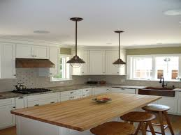 industrial pendant lighting over small kitchen island with seating