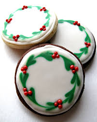 chocolate covered oreos and iced christmas sugar cookies for