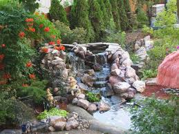 the idea of diy pond fountain for cooling effect in your garden
