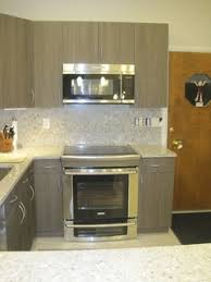 Thermofoil White Cabinets What Do You Think - Kitchen cabinet heat shield