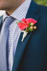 coral boutonniere bright coral boutonniere with hypericum berries