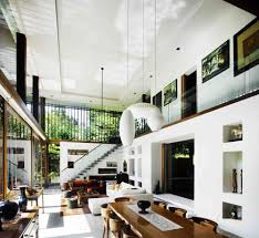 living room brown wooden dining table white sofa pendant light