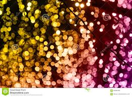 christmas background of colored glowing bokeh garlands