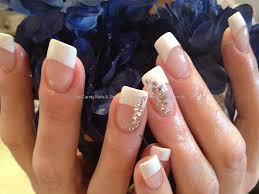 white tips with acrylic overlays and swarovski crystal ring