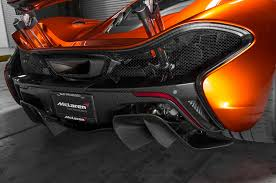 orange mclaren rear 2015 mclaren p1 vs 2015 porsche 918 spyder comparison motor trend