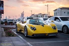 custom pagani yellow pagani zonda f in dubai arab license plate front view