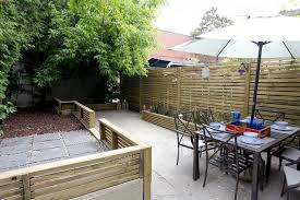 small courtyard designs patio contemporary with swan chairs horizontal fence panels patio contemporary with courtyard fence