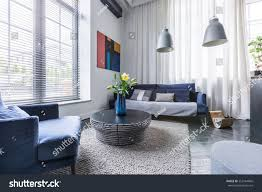 living room blue upholstered furniture window stock photo