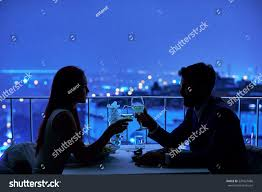 dinner silhouette young couple restaurant having dinner silhouette stock photo