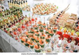 table canapé different canapes smoked salmon cucumber cherry stock photo royalty