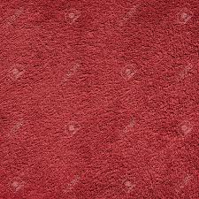 redcolor dark red color towel cloth material fragment as a background