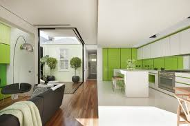 With bright white interiors and lime green accents sliding doors that open to the outdoors solar passive design and eco friendly landscaping this home