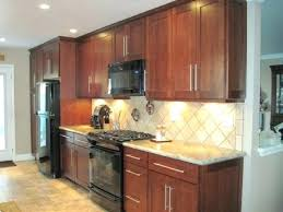 pictures of kitchens with black appliances what color cabinets go with black appliances openpoll me