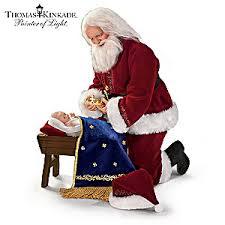 santa kneeling at the manger kinkade to the newborn king santa doll