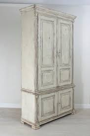 Swedish Painted Furniture Painted Swedish Armoire With Raised Panels And Fluted Pilasters