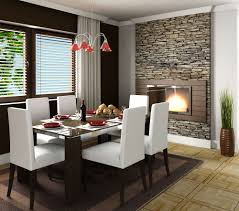 the modern dining room the modern fireplace is the center of attraction here complimented