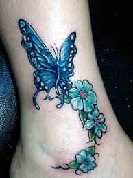 blue butterfly and green fklowers on ankle tattoos