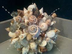 wedding bouquets with seashells yellow seashell wedding bouquet bouquet by slycreations