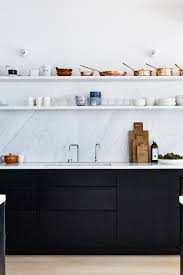carrara marble tile backsplash stainless steel stove and oven
