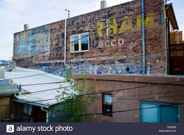 old murals painted on the brick wall of a building in historic downtown district small mountain town of salida colorado usa