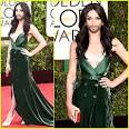 Conchita Wurst is Gorgeous Green and Unstoppable on Golden Globes.