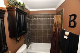 small bathroom design with wooden vanity and fancy shower curtain