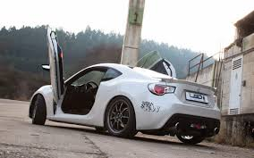 subaru brz vs scion frs vs toyota gt86 toyota gt86 gets the lambo door treatment spec race to launch in