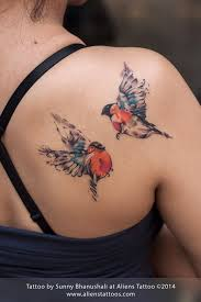 small colorful birds tattoos