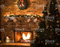 cozy christmas fireplace scene with roaring fire stock photo