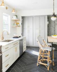 white kitchen cabinets black tile floor white and gold kitchen with black herringbone floor tiles