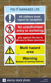 a health and safety sign outside a garage workshop stock photo