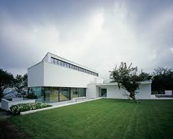 white exterior color with vast modern lawn for german style house