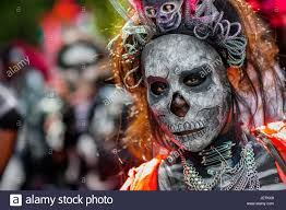 a young woman dressed as la catrina a mexican pop culture icon